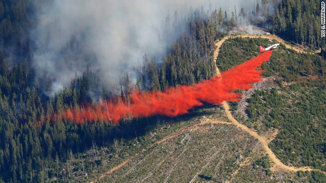 A plane drops fire retardant on a wildfire near Leavenworth, Washington, on Thursday, July 17.