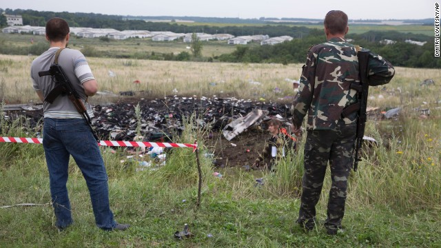 Pro-Russia separatists stand guard at the crash site of Malaysia Airlines Flight 17 in eastern Ukraine near the Russian border on Friday, July 18.
