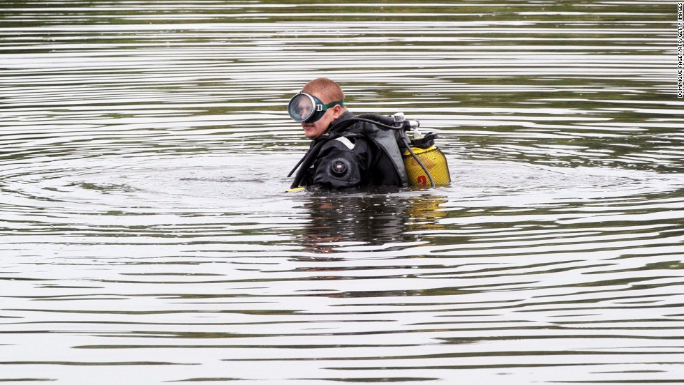 A diver searches for the jet's flight data recorders on July 18, 2014.