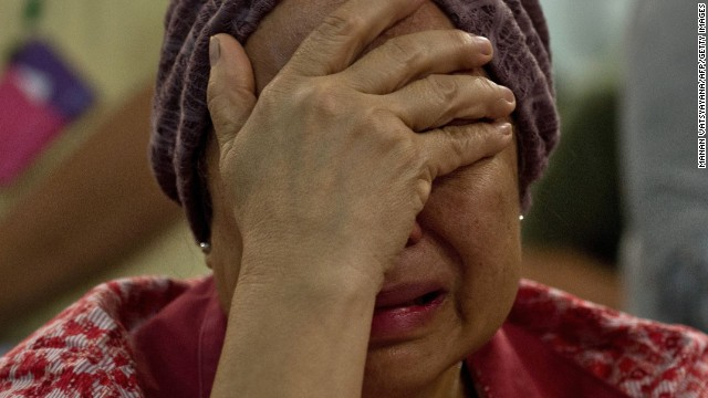 "Akmar Binti Mohd Noor, 67, whose sister was onboard Malaysia Airlines flight MH17 from Amsterdam cries outside the family holding area at the Kuala Lumpur International Airport in Sepang on July 18, 2014. A Malaysian airliner carrying 295 people from Amsterdam to Kuala Lumpur crashed on July 17 in rebel-held east Ukraine, as Kiev said the jet was shot down in a ""terrorist"" attack. Ukraine's government and pro-Russian insurgents traded blame for the disaster, with comments attributed to a rebel commander suggesting his men may have downed Malaysia Airlines flight MH17 by mistake, believing it was a Ukrainian army transport plane. AFP PHOTO/ MANAN VATSYAYANA        (Photo credit should read MANAN VATSYAYANA/AFP/Getty Images)"
