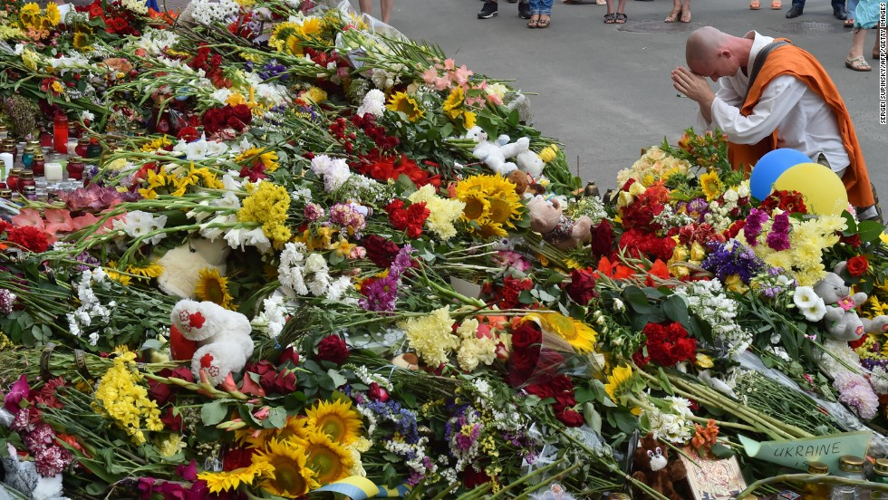 A man prays at a memorial in front of the Dutch Embassy in Kiev on July 18.