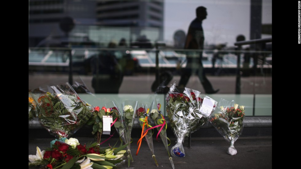 Floral tributes adorn the entrance to Schiphol Airport in Amsterdam.