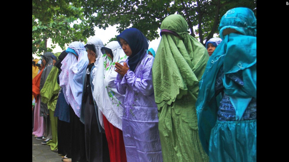 Students attend a prayer July 18 in Central Java, Indonesia. Their teacher John Paulissen was a passenger on Flight 17.