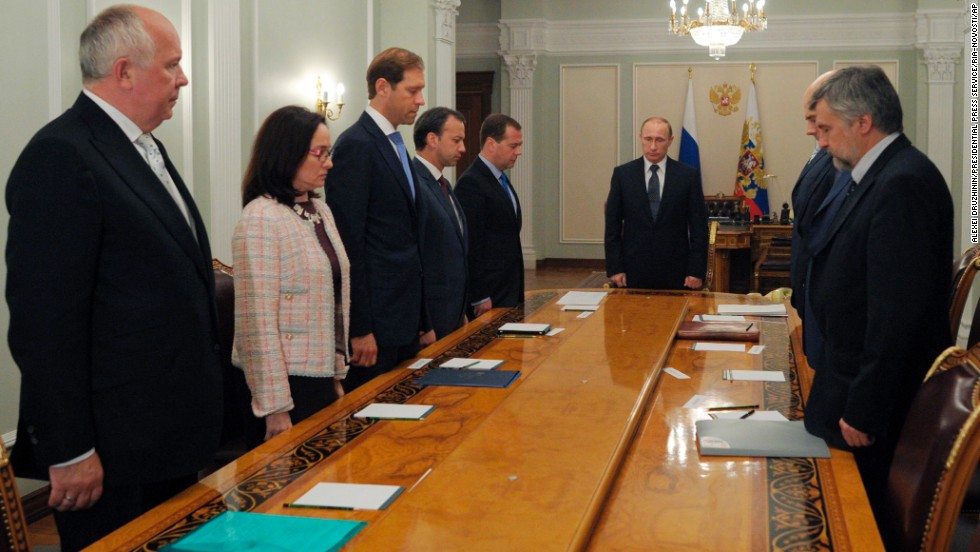 Russian President Vladimir Putin, center, and members of his government observe a moment of silence on Thursday, July 17.