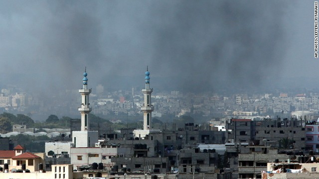 Smoke rises after an Israeli missile strike in Gaza City, northern Gaza Strip, Friday, July 18, 2014.