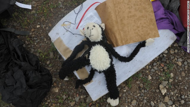 A toy monkey is seen among the debris from the crash.