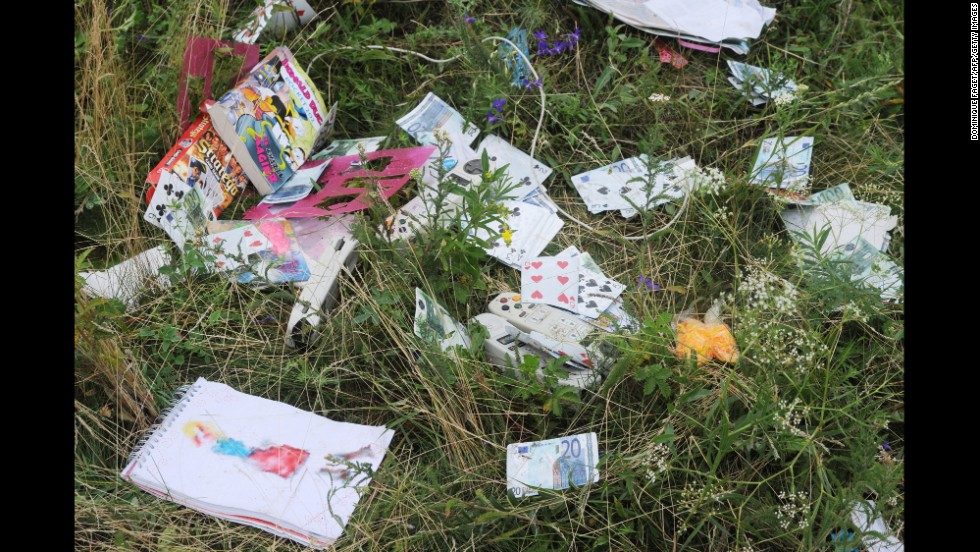 Playing cards and euros are seen at the crash site.