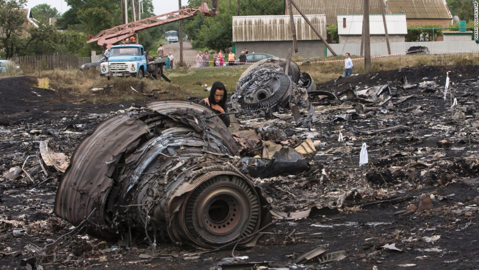 A woman walks through the debris field on July 18, 2014.