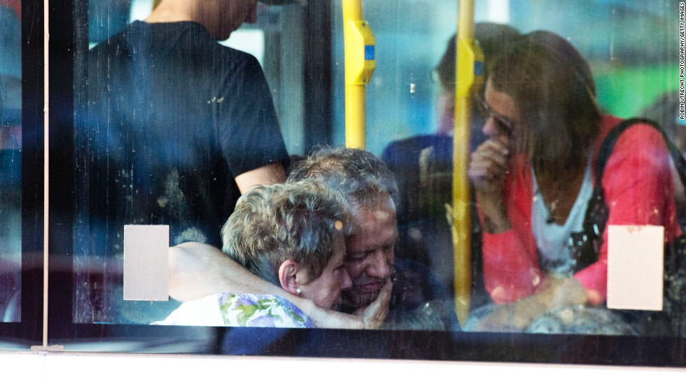 Family members of victims leave Schiphol Airport on July 17 in Amsterdam.