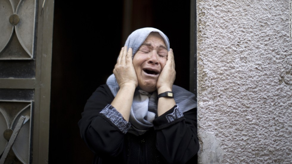 A relative mourns July 18 during the funeral of Rani Abu Tawila, a Palestinian who was killed in an Israeli attack on Gaza City.