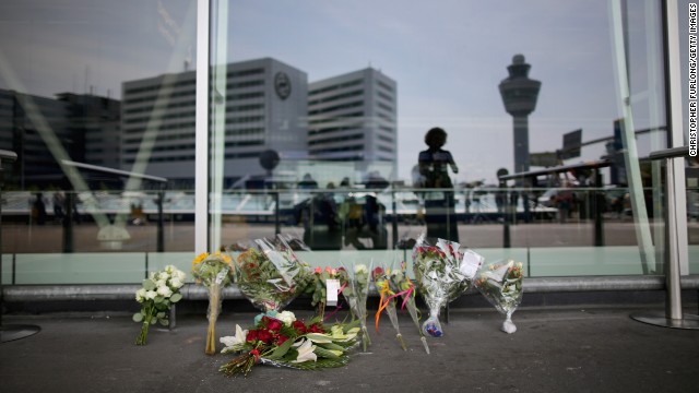 Floral tributes adorn the entrance to Schiphol Airport in memory of the victims of Malaysia Airlines flight MH17 on July 18, 2014 in Amsterdam, Netherlands.
