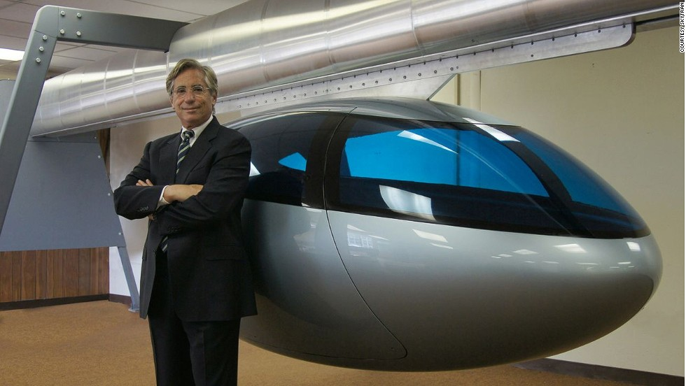"SkyTran CEO Jerry Sanders with a model pod. ""Being stuck in traffic is just the most stress-inducing, soul-crushing part of society today,"" says Sanders. ""We really want to make people's lives better and elevated, high-speed transportation is the answer."""
