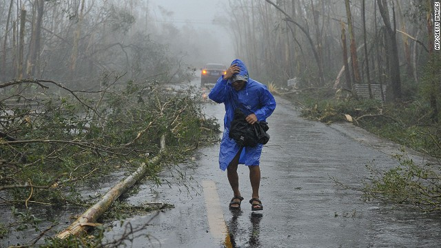 A man walks past fallen trees on a street after super typhoon Rammasun hit the area in Wenchang, south China's Hainan province on July 18, 2014. China braced for a powerful super typhoon heading for its southern coast after the storm left a trail of destruction and at least 40 dead in the neighbouring Philippines.China's National Meteorological Center (NMC) said Super Typhoon Rammasun was on course to hit Hainan island and Guangdong province late in the afternoon. CHINA OUT AFP PHOTOSTR/AFP/Getty Images