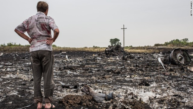 A man looks at debris from an Air Malaysia plane crash on July 18, 2014 in Grabovka, Ukraine. Air Malaysia flight MH17 travelling from Amsterdam to Kuala Lumpur has crashed on the Ukraine/Russia border near the town of Shaktersk. The Boeing 777 was carrying 280 passengers and 15 crew members