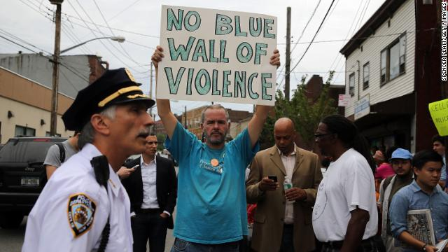 People participate in a demonstration against the death of Eric Garner after he was taken into police custody.