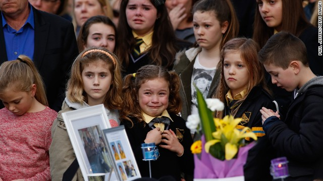 Mourners attend a memorial service held for a family of five killed in the flight MH17 disaster, in the suburb of Eynesbury on July 20, 2014 in Melbourne, Australia.