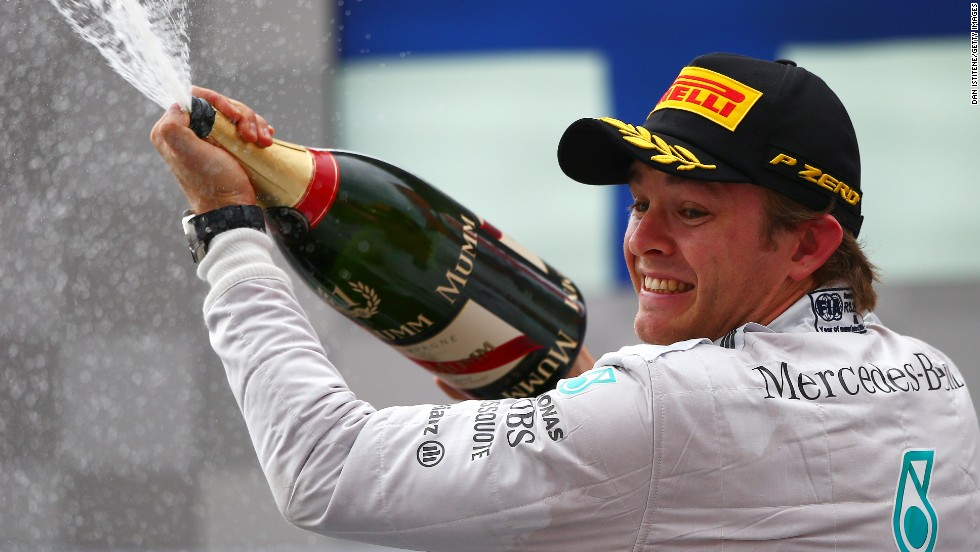Nico Rosberg enjoys a champagne moment after wrapping up victory in the German Grand Prix at Hockenheim.