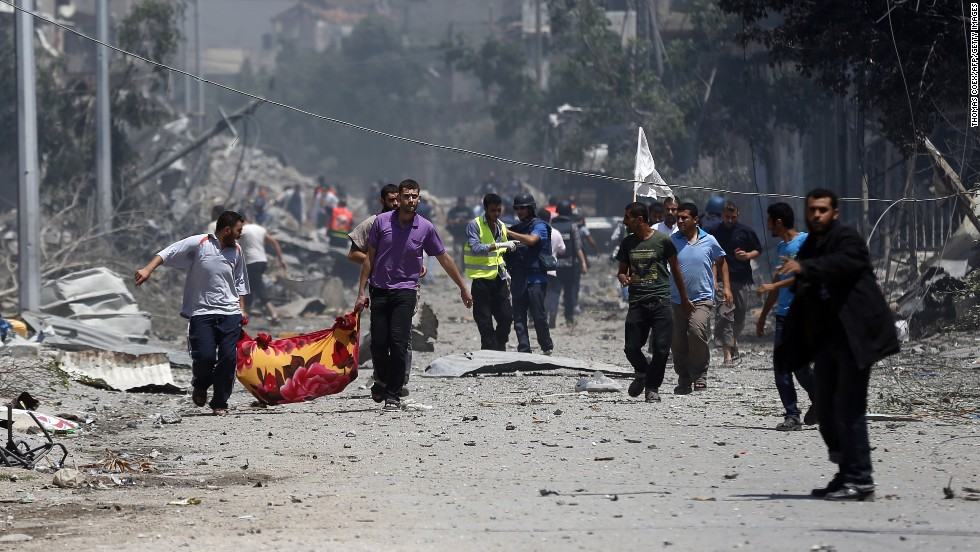 Palestinian medics carry a body in Gaza's Shaja'ia district on July 20.