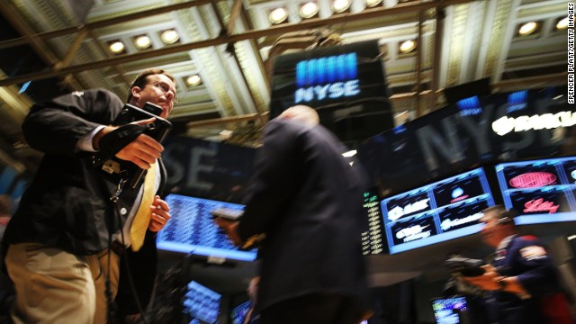Caption:NEW YORK, NY - JULY 14: Traders work on the floor of the New York Stock Exchange (NYSE) on July 14, 2014 in New York City. As investors prepare for a series of earnings reports this week, markets started off to a positive start on Monday. The Dow Jones Industrial Average was up 129 points in morning trading. (Photo by Spencer Platt/Getty Images)