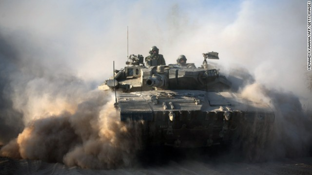 An Israeli soldier is seen on a Merkava tank, as part of the Israeli army deployment near Israel's border with the Gaza Strip on July 20, 2014. The number of Palestinians killed in Israeli attacks in the Gaza Strip on July 20 was at least 100. It was the bloodiest single day in the battered enclave in five years, taking the Palestinian toll on the 13th day of Israel's Gaza offensive to 438. AFP PHOTO / MENAHEM KAHANA (Photo credit should read MENAHEM KAHANA/AFP/Getty Images)