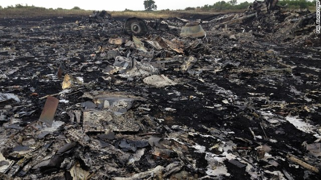 """HRABOVE, UKRAINE:  """"When the sun came up we saw this...and much worse."""" - CNN's Phil Black, July 19.  Photo shows the crash site of Malaysian Airlines Flight MH17, which was shot down over Ukraine.  Folllow Phil (@philblackcnn) and other CNNers along on Instagram at instagram.com/cnn."""