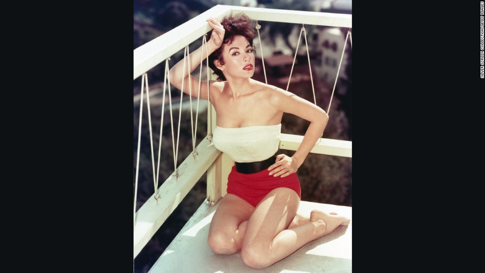 "Singer and actress Rita Moreno, famous for her early role as Anita in ""Westside Story,"" poses for a sizzling pin-up style photo."