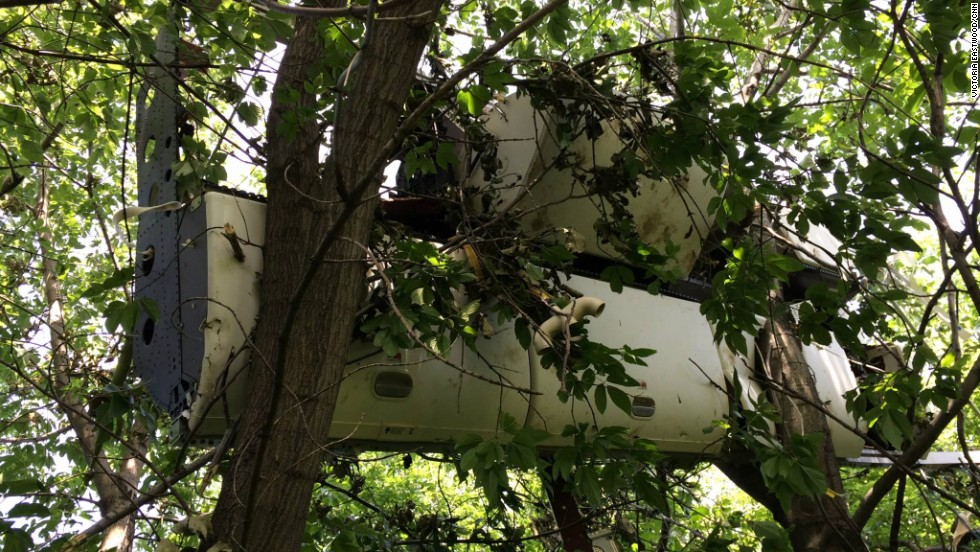 New Day's Chris Cuomo reported from eastern Ukraine and at the crash site of Malaysia Airlines Flight 17 and provided these photos.  Here, an overhead compartment from Malaysia Airlines Flight 17 rests intact in a tree near the crash site in Hrabove, Ukraine.