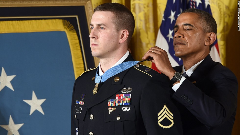 Former U.S. Army Staff Sgt. Ryan J. Pitts receives the Medal of Honor in July for his actions during a battle in Afghanistan in 2008. According to the Army, Pitts launched grenade after grenade under a hail of enemy gunfire as comrades at other nearby posts fell. He also asked other soldiers to fire at his position to prevent the enemy from gaining ground.