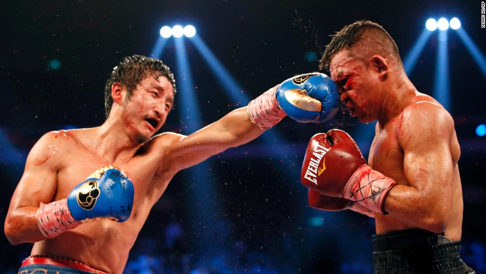 Zou Shiming punches Luis De La Rosa during their WBO International flyweight title bout Saturday, July 19, in Macau, China. Zou won by unanimous decision.