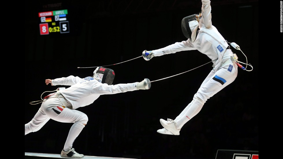 Germany's Britta Heidemann, left, competes against Estonia's Erika Kirpu on Sunday, July 20, during the World Fencing Championships in Kazan, Russia. Heidemann defeated Kirpu in what was the semifinal match of the women's epee event, but she lost to Italy's Rossella Fiamingo in the final.