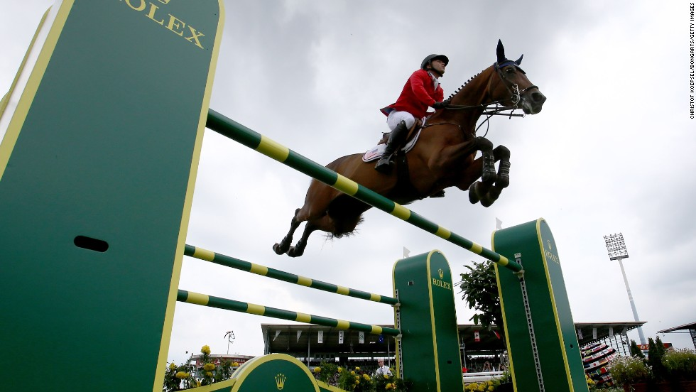 Kent Farrington rides on Voyeur, finishing second in the Rolex Grand Prix jumping competition that was held Sunday, July 20, at the CHIO Aachen horse show in Aachen, Germany.