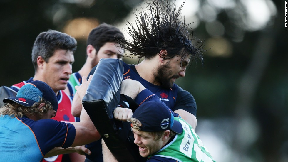 Rugby player Jacques Potgieter of the New South Wales Waratahs is tackled during a training session Monday, July 21, in Sydney.