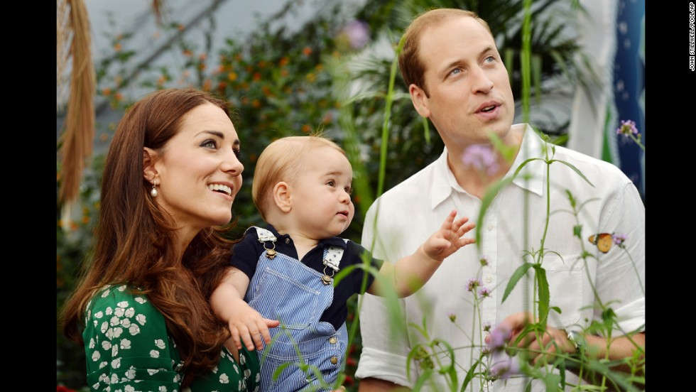 Britain's Prince George and his parents, Prince William and Duchess Catherine, visit a butterfly exhibition at London's Natural History Museum on July 2. Prince George celebrates his first birthday on Tuesday, July 22.