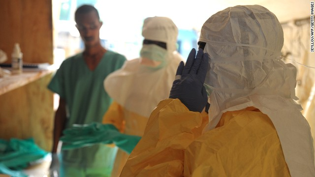 Health specialists prepare for work at a Doctors Without Borders isolation ward in Guekedou, Guinea