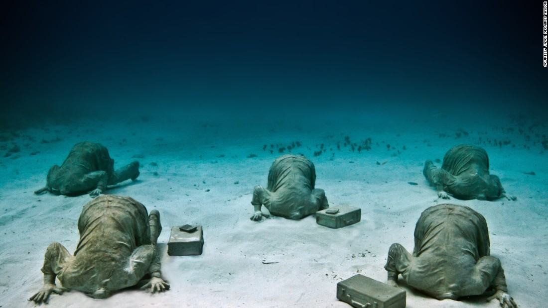 "Even in Mexico the artist doesn't shy away from a strong metaphor, such as the installation shown above where figures have their heads literally buried in sand: ""This was a piece referencing climate change and global warming, and how we tend to be living in denial at the moment, forgetting the future for short term gain,"" he said.."