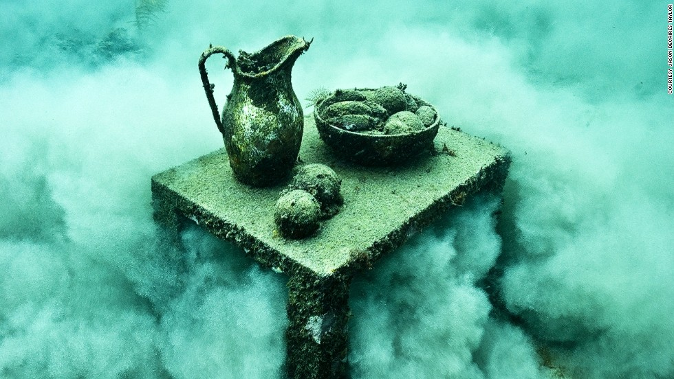 <em>Un-still Life</em><br /><br />The artist makes the sculptures as heavy as possible so they would stay on the seabed once secured, and then transports them underwater in a process that can last up to six months. Works are made of PH neutral cement, and over time sponges and coral encrust the surfaces in myriad of colorful and unexpected patterns.