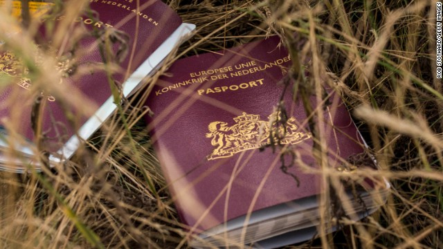 Two Dutch passports lie in the field on July 22.