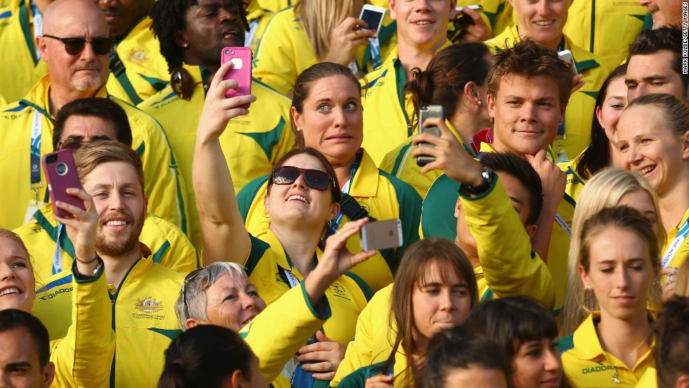 "Members of the Australian team take selfies Monday, July 21, as they wait for their photo at the Commonwealth Games in Glasgow, Scotland. <a href=""http://www.cnn.com/2014/07/16/world/gallery/look-at-me-0716/index.html"">See 14 selfies from last week</a>"