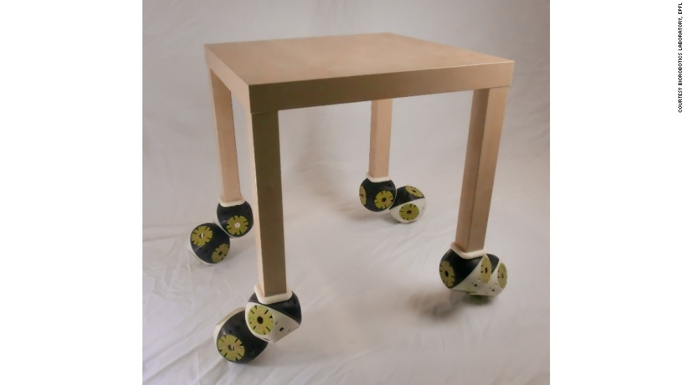 """Roombots modules connected to an existing table, demonstrating its """"plug and play"""" capabilities."""
