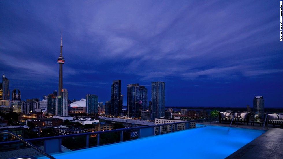 The terrace that wraps all the way around the Rooftop Lounge at the Thompson Toronto Hotel offers views of Lake Ontario that whip you away from the city-feel in an instant.