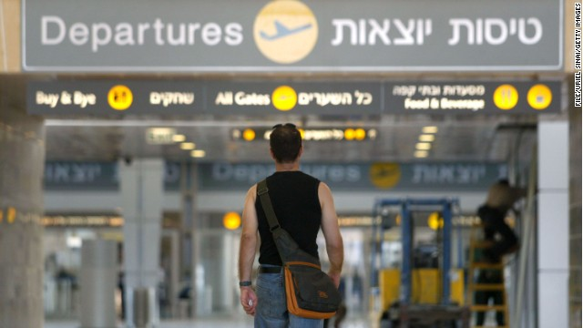 A man walks up to the departures hall in the new terminal under construction at the Ben Gurion International Airport October 21, 2004 in Israel.