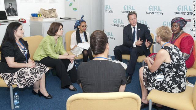 British PM David Cameron meets activists at 'Girl Summit 2014' at Walworth Academy on July 22, 2014 in London, England.