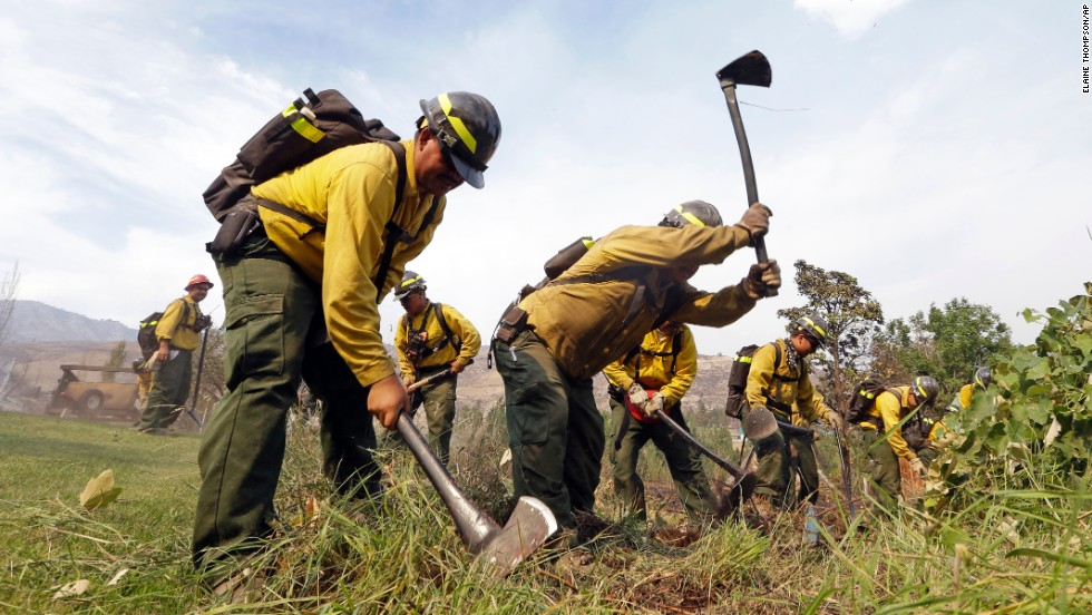 Firefighters dig a fire line July 18 in Winthrop.