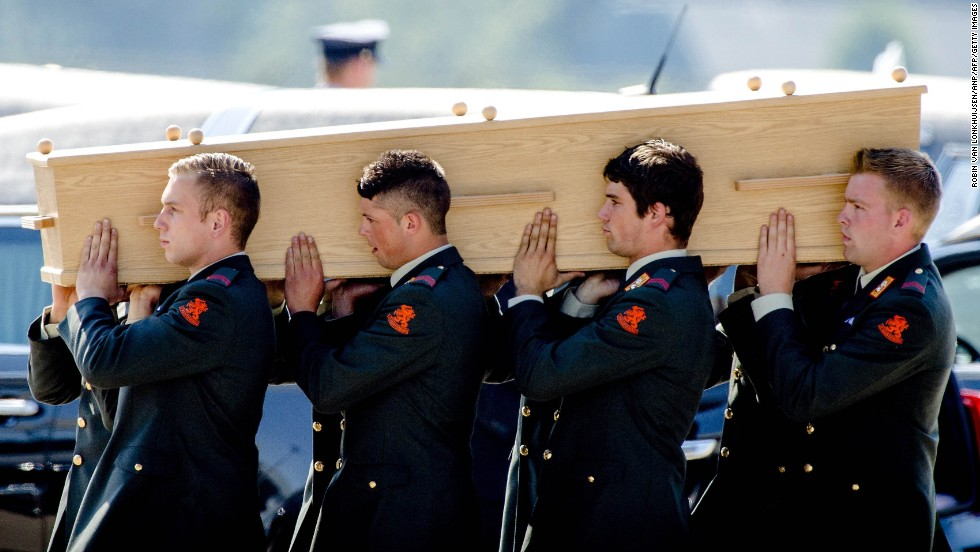 Dutch military personnel carry a coffin to a hearse in Eindhoven on July 23.