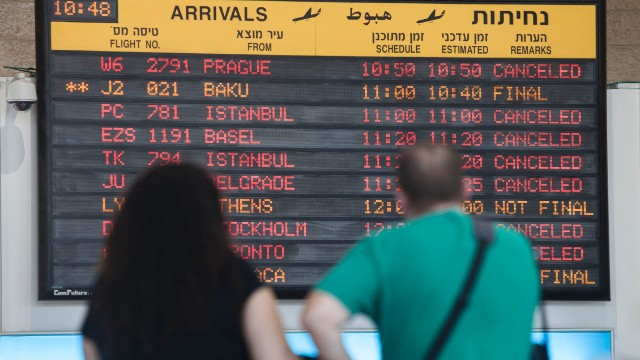 A departure flight board displays various canceled and delayed flights in Ben Gurion International airport a day after the U.S. Federal Aviation Administration imposed a 24-hour restriction on flights after a Hamas rocket landed Tuesday within a mile of the airport, in Tel Aviv, Israel, Wednesday, July 23, 2014. U.S. Secretary of State John Kerry flew into Israel's main airport Wednesday despite a Federal Aviation Administration ban in an apparent sign of his determination to achieve a cease-fire agreement in the warring Gaza Strip despite little evidence of progress in ongoing negotiations. (AP Photo/Dan Balilty)