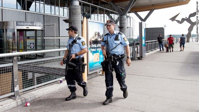 Armed police patrol outside the terminal at Oslo Airport on Thursday, July 24.