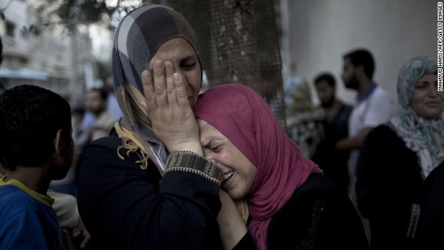 Palestinian women grieve over the death of relatives outside the morgue of the Kamal Adwan hospital in Beit Lahiya, on July 24, 2014, after a UN school in the northern Beit Hanun district of the Gaza Strip was hit by an Israeli shell. Fifteen Palestinians were killed when the Israeli shell slammed into the UN-run school where hundreds of civilians had taken refuge, sending the death toll in Gaza soaring to 777 despite world efforts to broker a ceasefire. AFP PHOTO/ MAHMUD HAMS        (Photo credit should read )