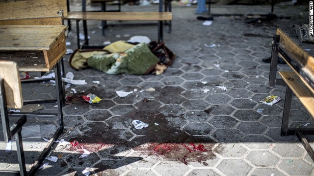 A trail of blood is seen in the courtyard of a UN School in the northern Beit Hanun district of the Gaza Strip on July 24, 2014, after it was hit by an Israeli tank shell. At least nine people were killed, including a baby, when an Israeli tank shell slammed into a UN-run school in the northern Gaza Strip, an AFP correspondent said. AFP PHOTO/MARCO LONGARIMARCO LONGARI/AFP/Getty Images