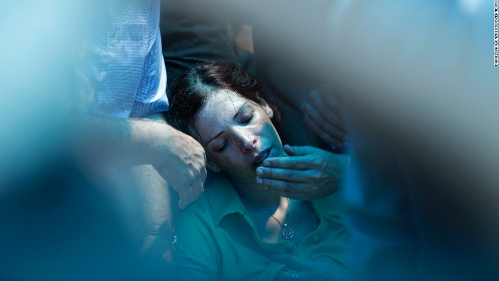 Dana, the sister of Israeli soldier Tsafrir Bar-Or, mourns during his funeral in Holon, Israel, on Monday, July 21.