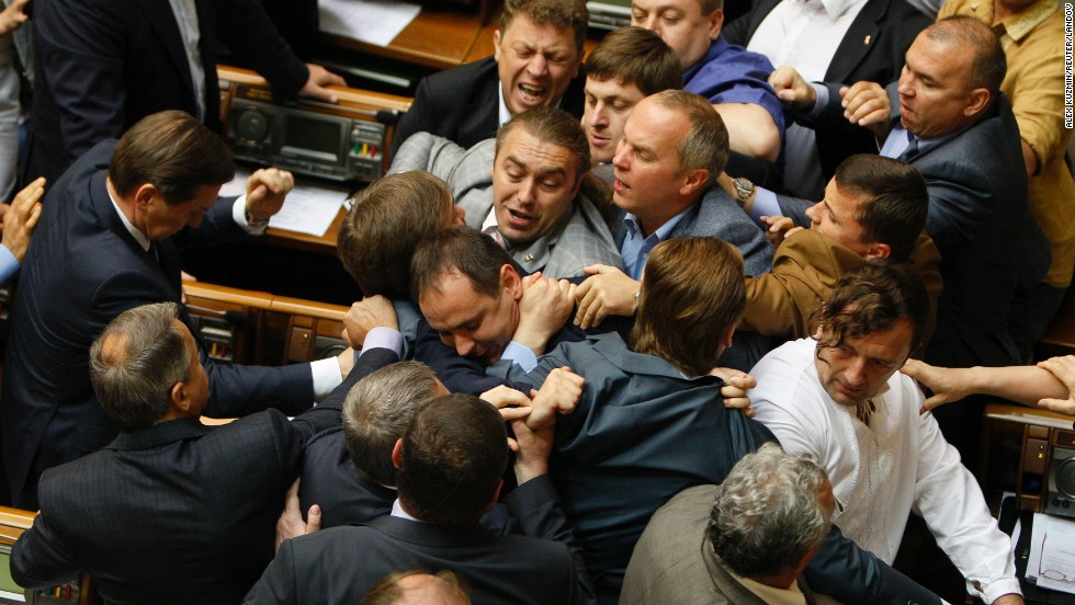 "Ukrainian lawmakers tussle during a Parliament session in Kiev, Ukraine, on Tuesday, July 22. According to <a href=""http://www.themoscowtimes.com/news/article/ukrainian-politicians-brawl-after-vote-to-send-military-reserves-east/503956.html"" target=""_blank"">The Moscow Times</a>, the brawl came after the narrow approval of a presidential decree that would send more reserve soldiers to fight pro-Russian rebels."